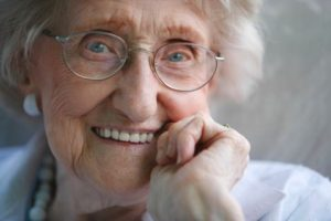 happy-old-woman-with-glasses